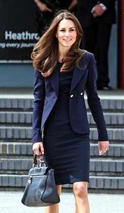 Catherine, The Duchess of Cambridge, arrives to board a plane of the Royal Canadian Air Force at London's Heathrow Airport to travel to Ottawa, Canada, on June 30, 2011. Prince William and his wife Catherine left Britain on Thursday for a nine-day tour of Canada, kicking off their first official foreign trip as husband and wife, a royal official said. The 29-year-old newlyweds flew out of London's Heathrow airport and will arrive in Ottawa later in the day, a royal spokeswoman told AFP.  AFP PHOTO / Steve Parsons / POOL